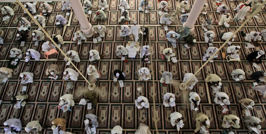 Pakistani religious students attend their examinations at the Jamia Binoria Islamic seminary in Karachi, Pakistan on Saturday, March 16, 2013.
