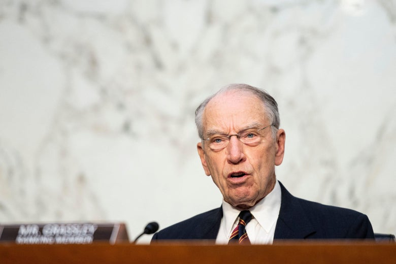 Grassley speaks into a microphone at a hearing.