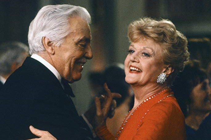 Angela Lansbury and Cesar Romero dancing.