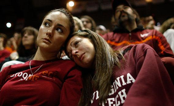 Virginia Tech students comfort one another during a convocation ceremony at Cassell Coliseum a day after a gunman shot and killed 32 people before turning the gun on himself April 17, 2007 in Blacksburg, Viriginia.