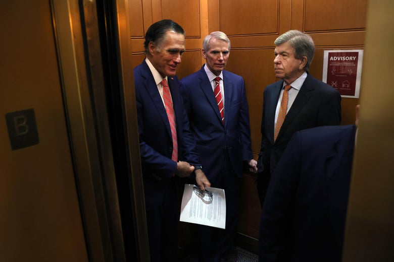 WASHINGTON, DC - JULY 13: (L-R) Sen. Mitt Romney (R-UT), Sen. Rob Portman (R-OH) and Sen. Roy Blunt (R-MO) ride an elevator as they leave a bipartisan meeting on infrastructure at the U.S. Capitol on July 13, 2021 in Washington, DC. The Senate returned from a two-week recess with hopes of passing a more than $1 trillion bipartisan infrastructure plan. (Photo by Kevin Dietsch/Getty Images)