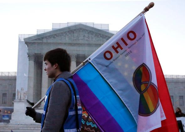 A protester from Ohio carries a flag outside of the U.S. Supreme Court.
