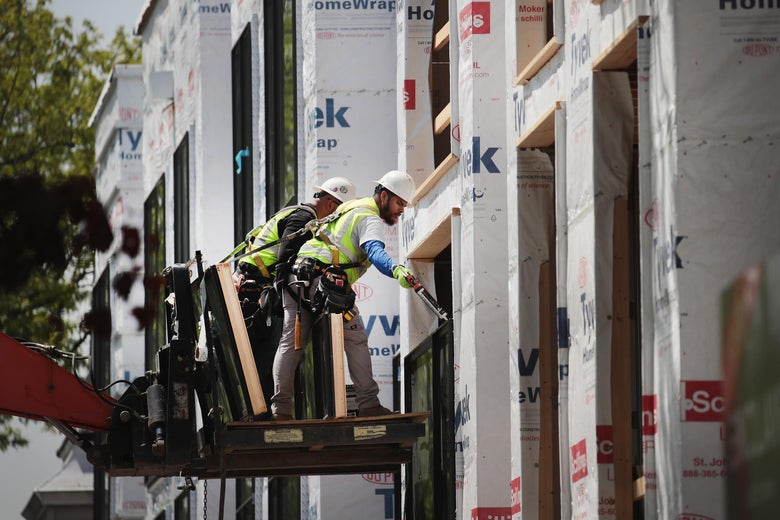 CHICAGO, IL - MAY 15:  Workers install windows in a townhome complex under construction on May 15, 2017 in Chicago, Illinois. The National Association of Home Builders said today that its housing-market index rose by two points in May, a signal of a strengthening housing market. New home construction statistics for April will be released by the United States Census Bureau on May 16.  (Photo by Scott Olson/Getty Images)