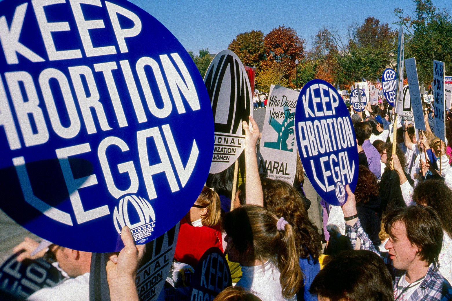 "Protesters hold ""Keep abortion legal"" signs."