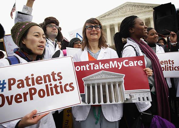 Supporters of the Affordable Care Act gather in front of the U.S Supreme Court during a rally.