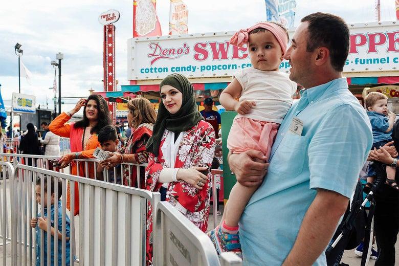 Muslim families celebrate Eid al-Fitr at Luna Park in Coney Island.