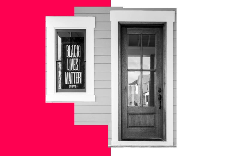 House with Black Lives Matter sign in the window