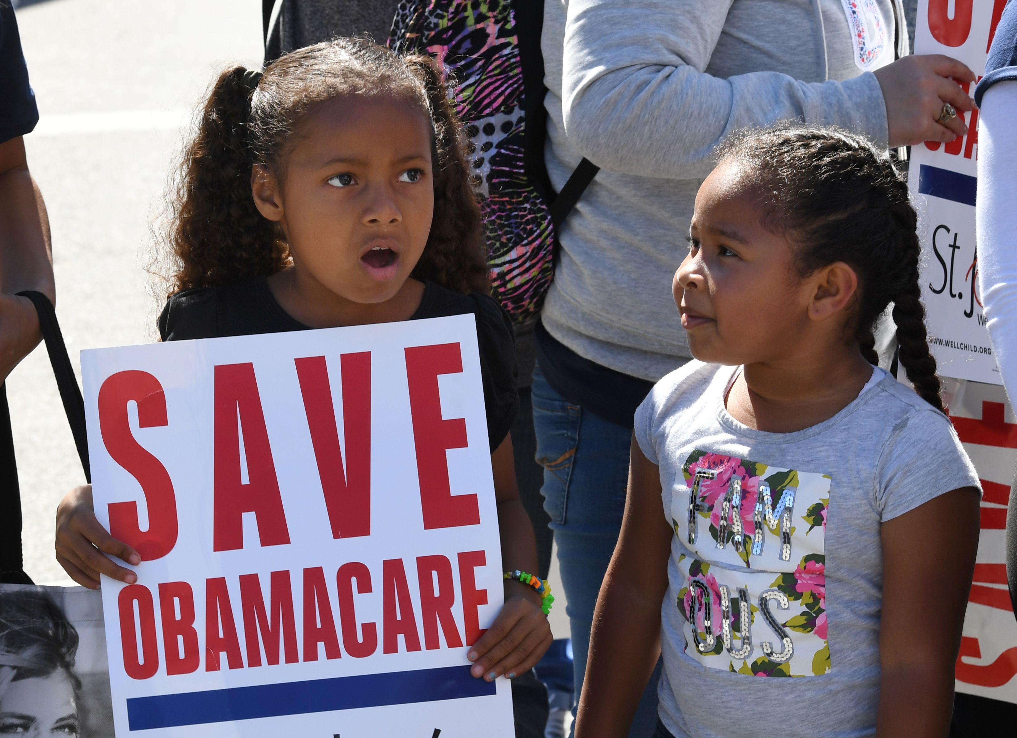 "Young protesters march toward the Federal Building during a ""Save the Affordable Care Act"" rally in Los Angeles."