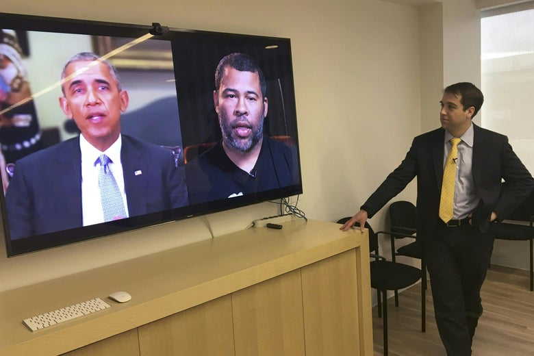 Vice President and Director of Studies at the Center for a New American Security Paul Scharre views in his offices a deepfake video of Barack Obama, created by filmmaker Jordan Peele.