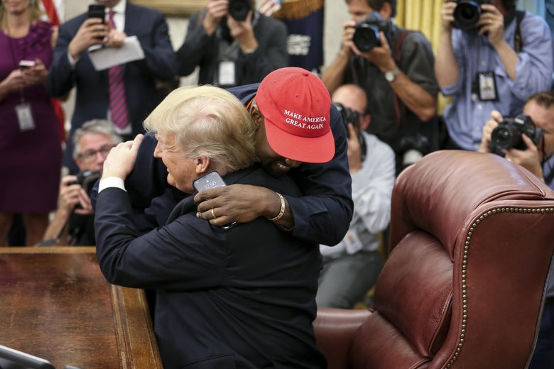 Rapper Kanye West hugs President Trump during a meeting in the Oval office on October 11, 2018.