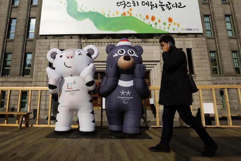 A South Korean man walks past the mascots of the 2018 PyeongChang Winter Olympic and Paralympic Games Soohorang (L) and Bandabi (R) on January 5, 2018 in Seoul, South Korea. North Korea accepted a proposal to hold talks with South Korea on Jan. 9 ahead of the Winter Olympics in February.