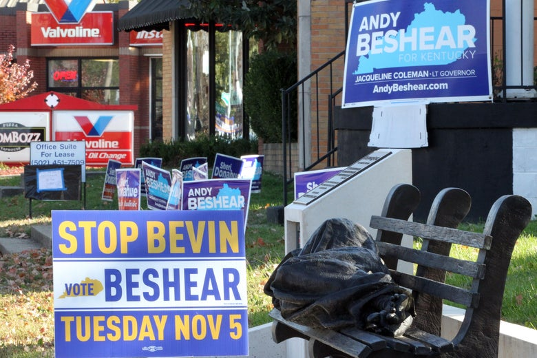 Campaign signs seen outside of a polling precinct in Kentucky