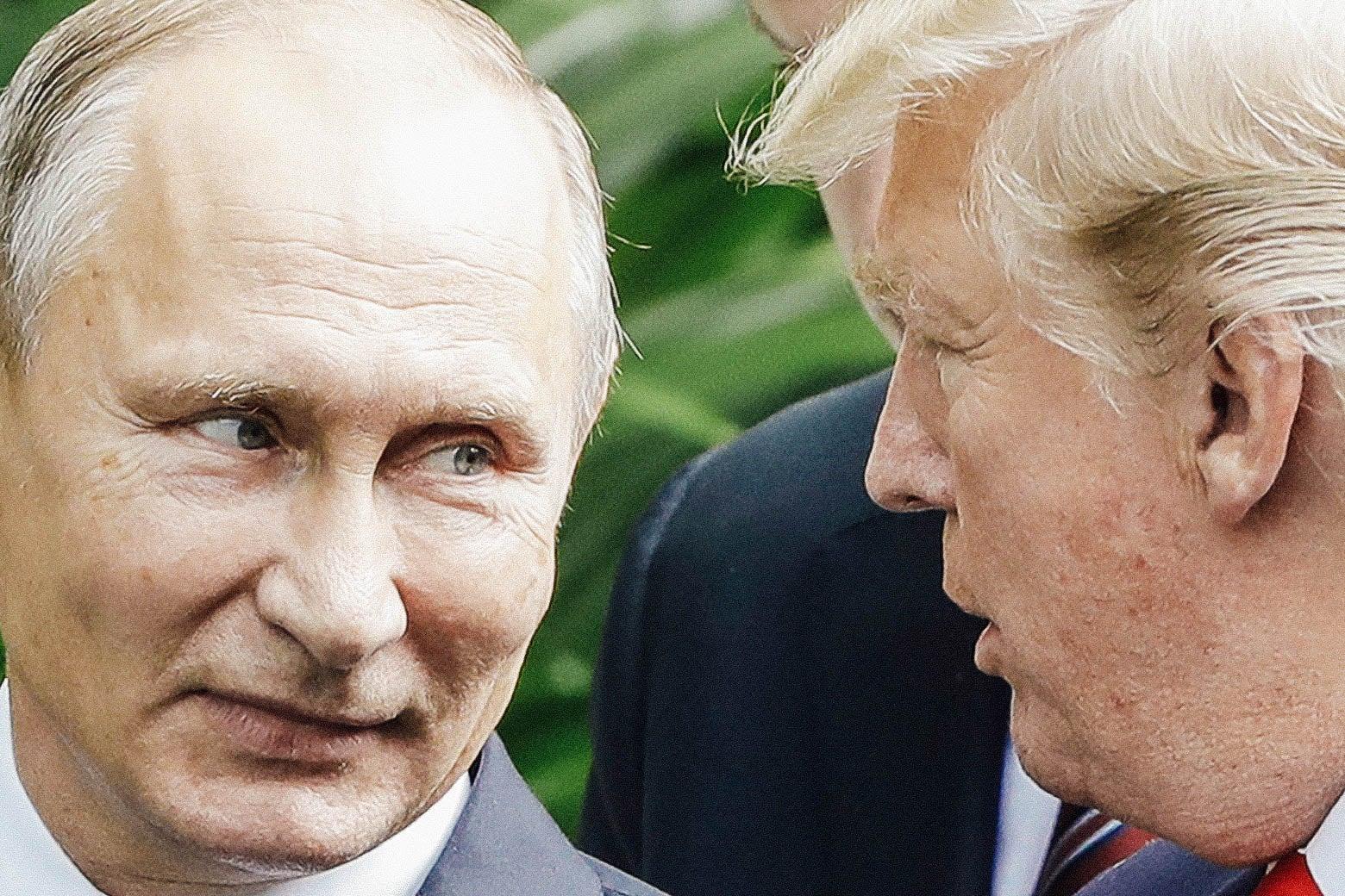 Vladimir Putin looks toward Donald Trump as they converse.