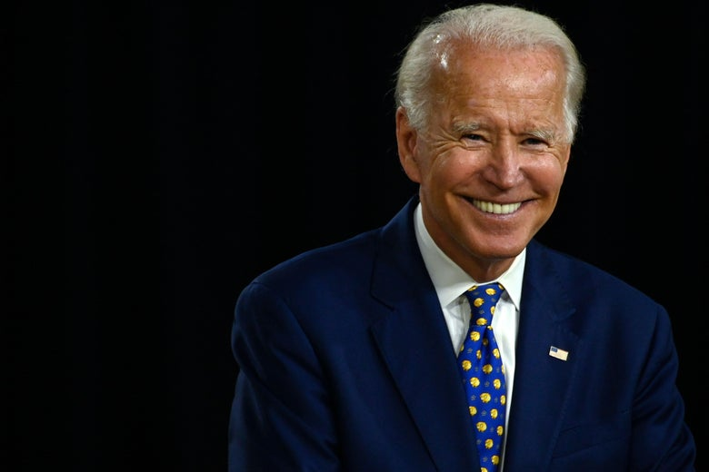 "Former Vice President Joe Biden smiles as he speaks during a campaign event at the William ""Hicks"" Anderson Community Center in Wilmington, Delaware on July 28, 2020."