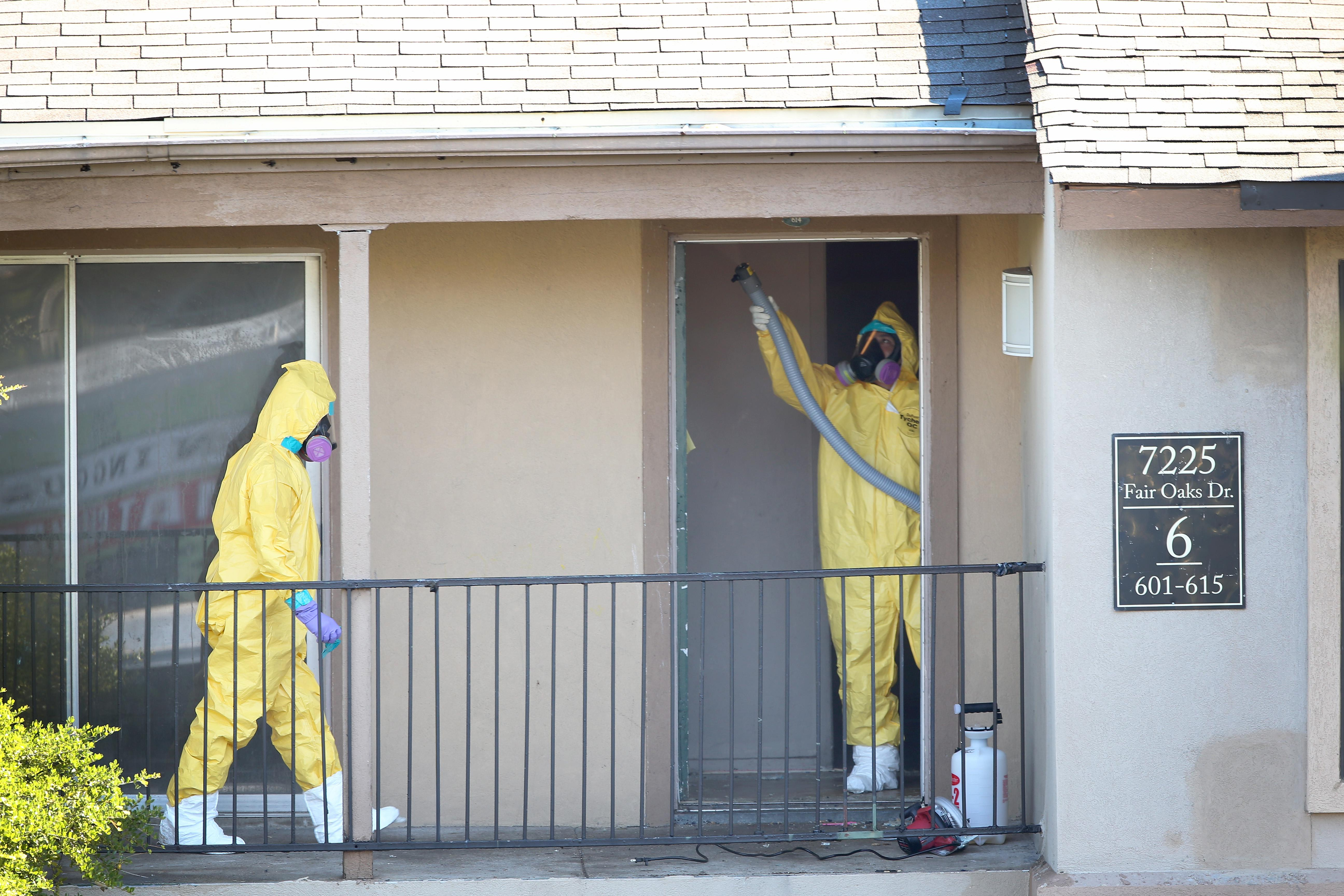 A cleaning crew sanitizes the apartment where Ebola patient Thomas Eric Duncan was staying before being admitted to a hospital on Oct. 6, 2014, in Dallas
