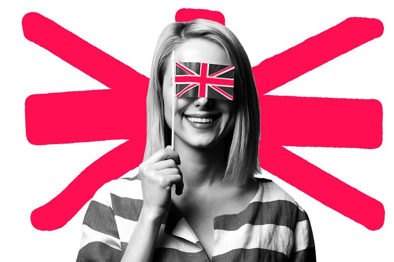 A woman holding a small British flag over her eyes.