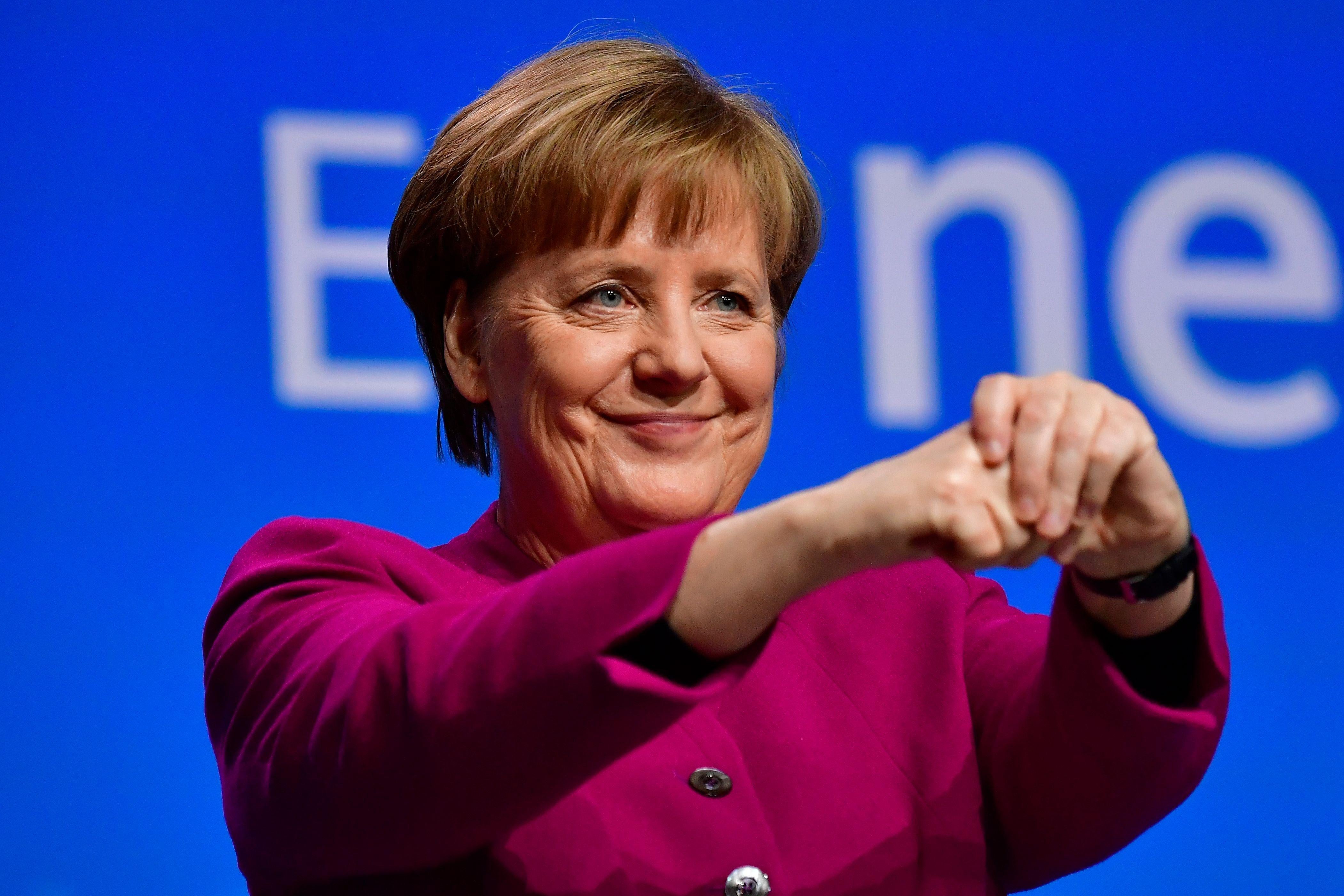 German Chancellor and leader of the conservative Christian Democratic Union (CDU) party Angela Merkel thanks delegates after giving a speech during the CDU's party congress on February 26, 2018 in Berlin.The CDU party of German Chancellor Angela Merkel is holding the congress to approve the coalition deal between the conservatives and the Social Democrats.