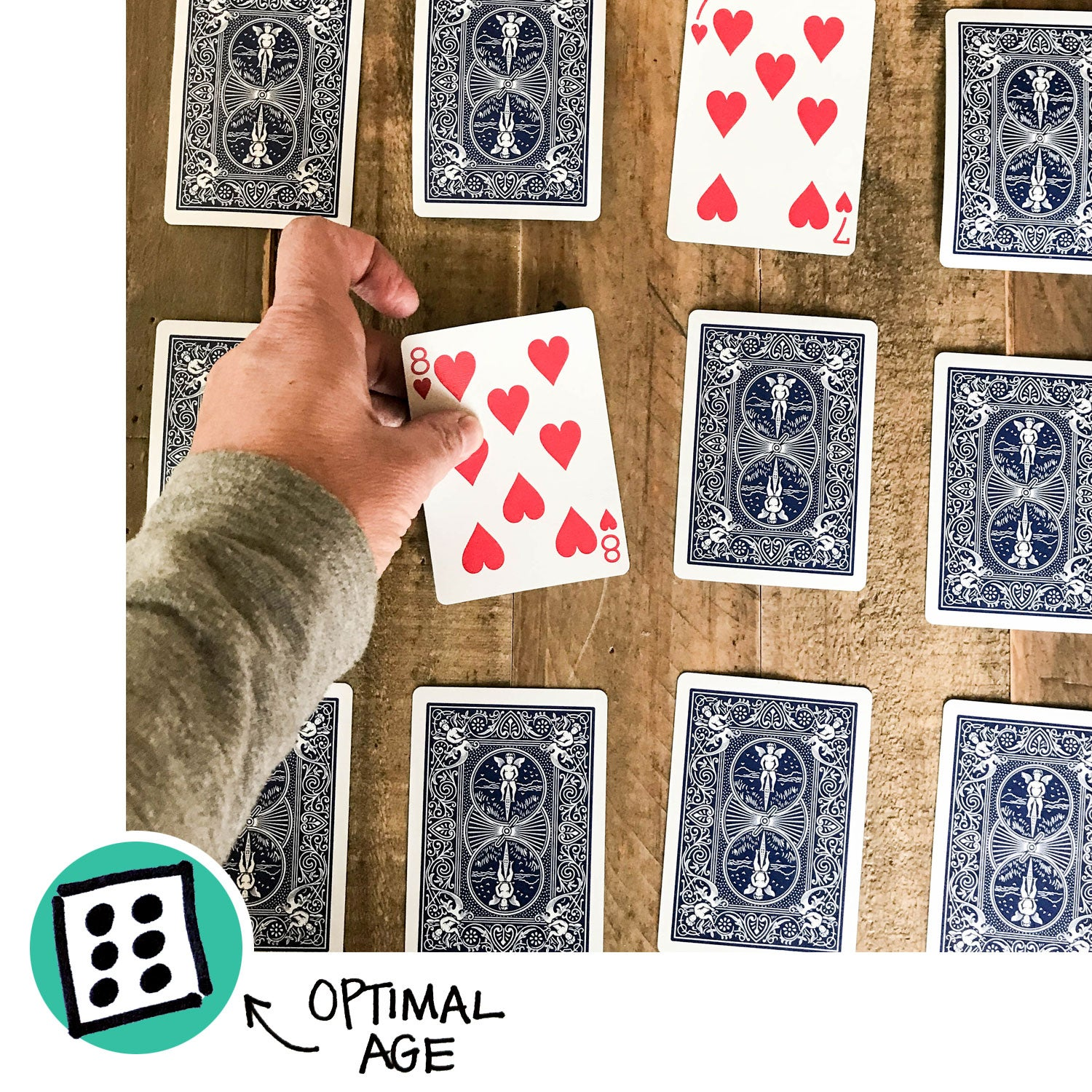A person playing Concentration with a deck of playing cards.