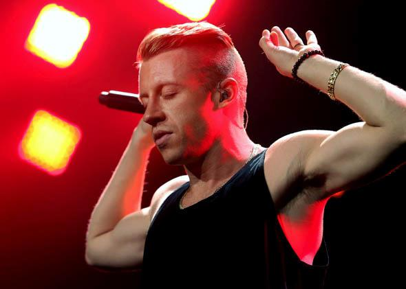 Macklemore performs onstage during KIIS FM's Jingle Ball 2013 on December 6, 2013 in Los Angeles, CA.