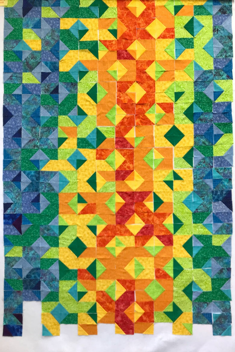 A quilt with reds, oranges, and yellows to represent hot temperatures and blues and greens to represent cool temperatures.