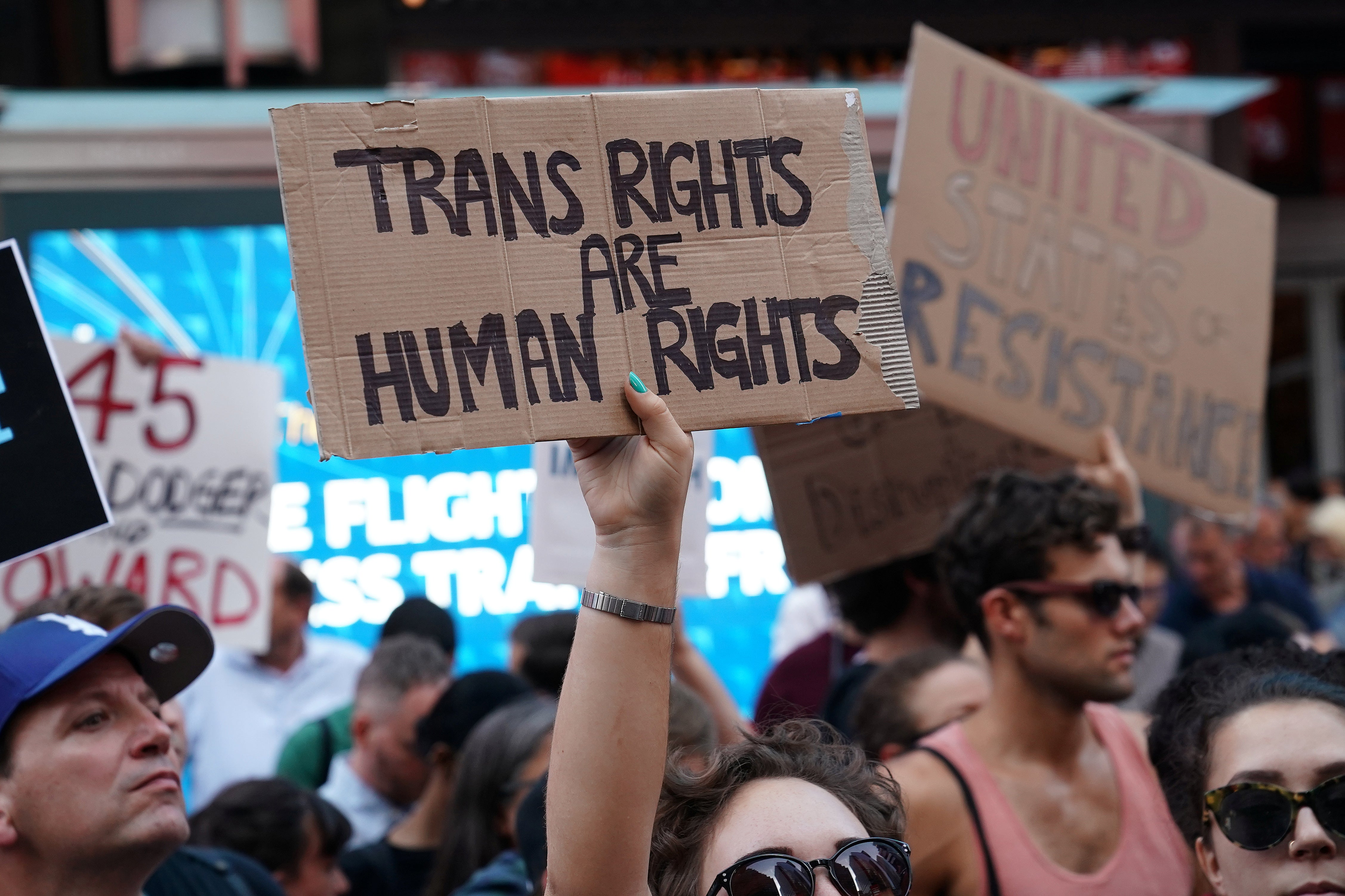 People protest President Donald Trump's announcement that he plans to reinstate a ban on transgender individuals from serving in any capacity in the U.S. military, in Times Square, New York on July 26, 2017.