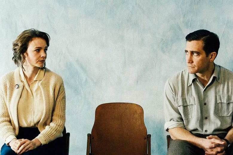 Carey Mulligan and Jake Gyllenhaal stare at each other while seated on either side of an empty chair.