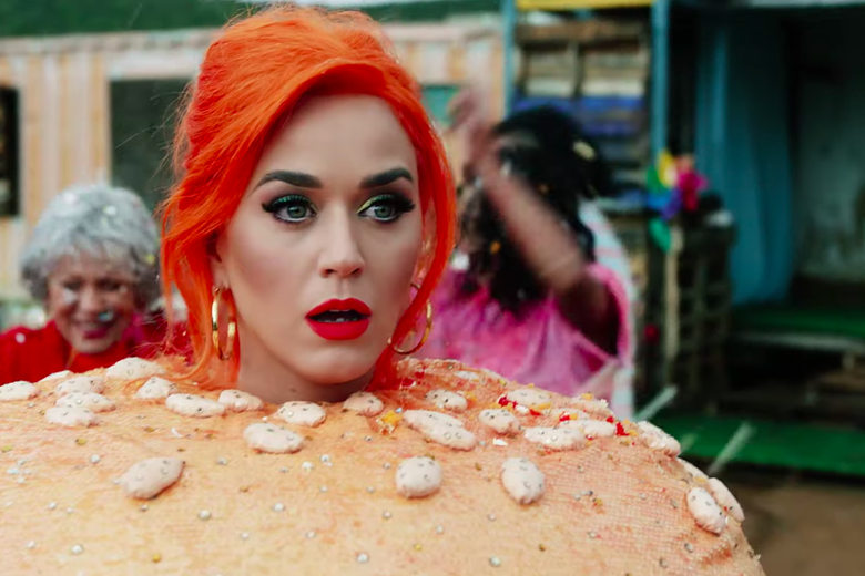 Katy Perry looking shocked while dressed as a burger.