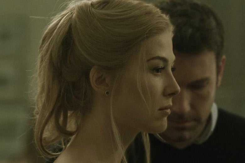 Rosamund Pike and Ben Affleck as Amy and Nick Dunne in Gone Girl.