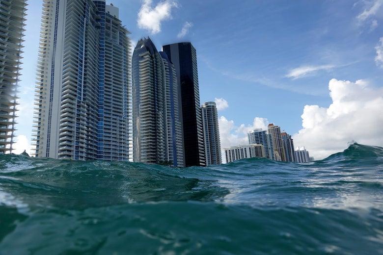 Waves lap ashore near condo buildings in Florida.