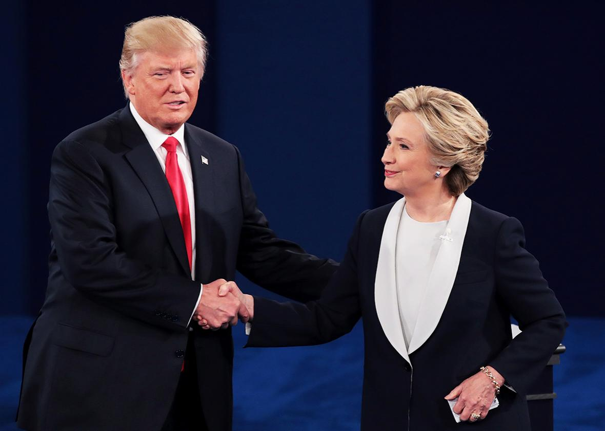 Republican presidential nominee Donald Trump shakes hands with Democratic presidential nominee former Secretary of State Hillary Clinton during the town hall debate at Washington University on October 9, 2016 in St Louis, Missouri.
