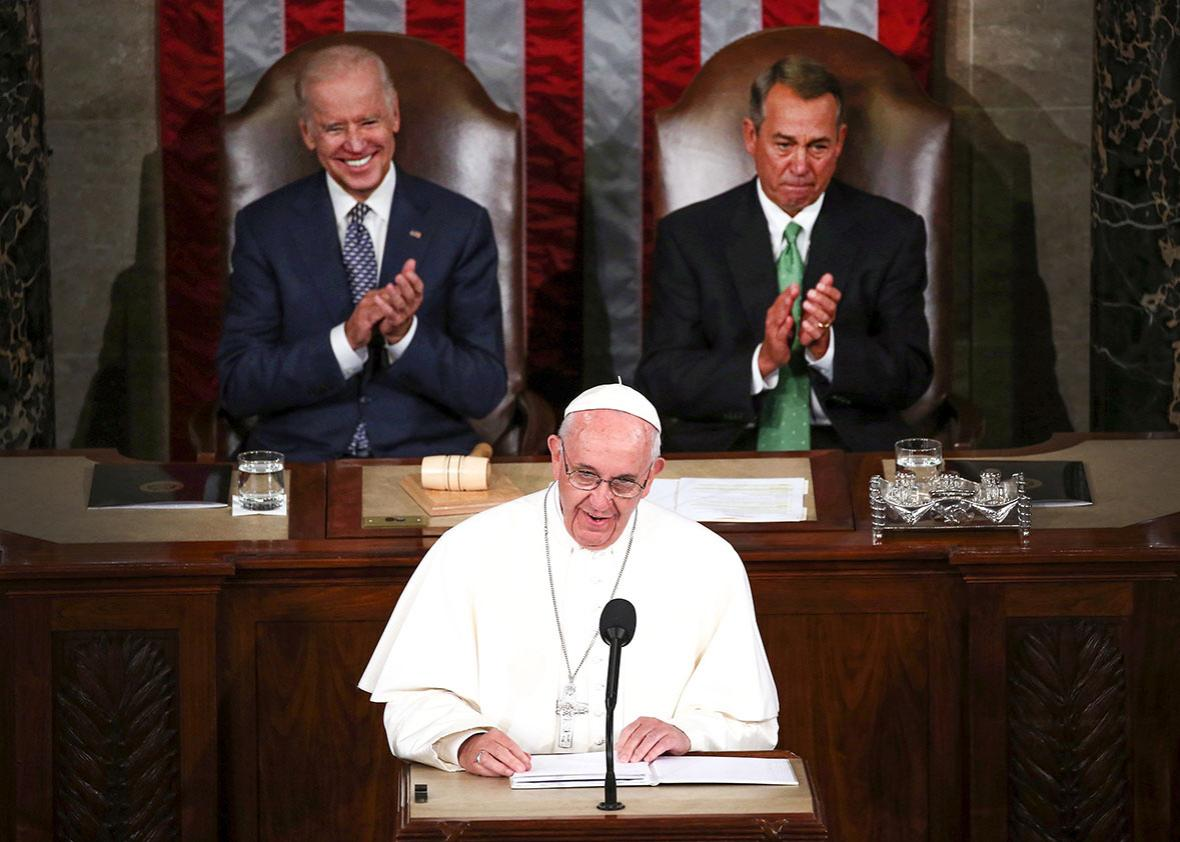 Pope Francis (C) addresses a joint meeting of the U.S. Congress with with Vice President Joe Biden (L) and Speaker of the House John Boehner.