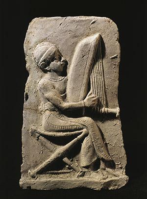 Terracotta relief depicting a harp player. Babylonian civilization, 2nd Millennium BC. Paris, Musee Du Louvre.