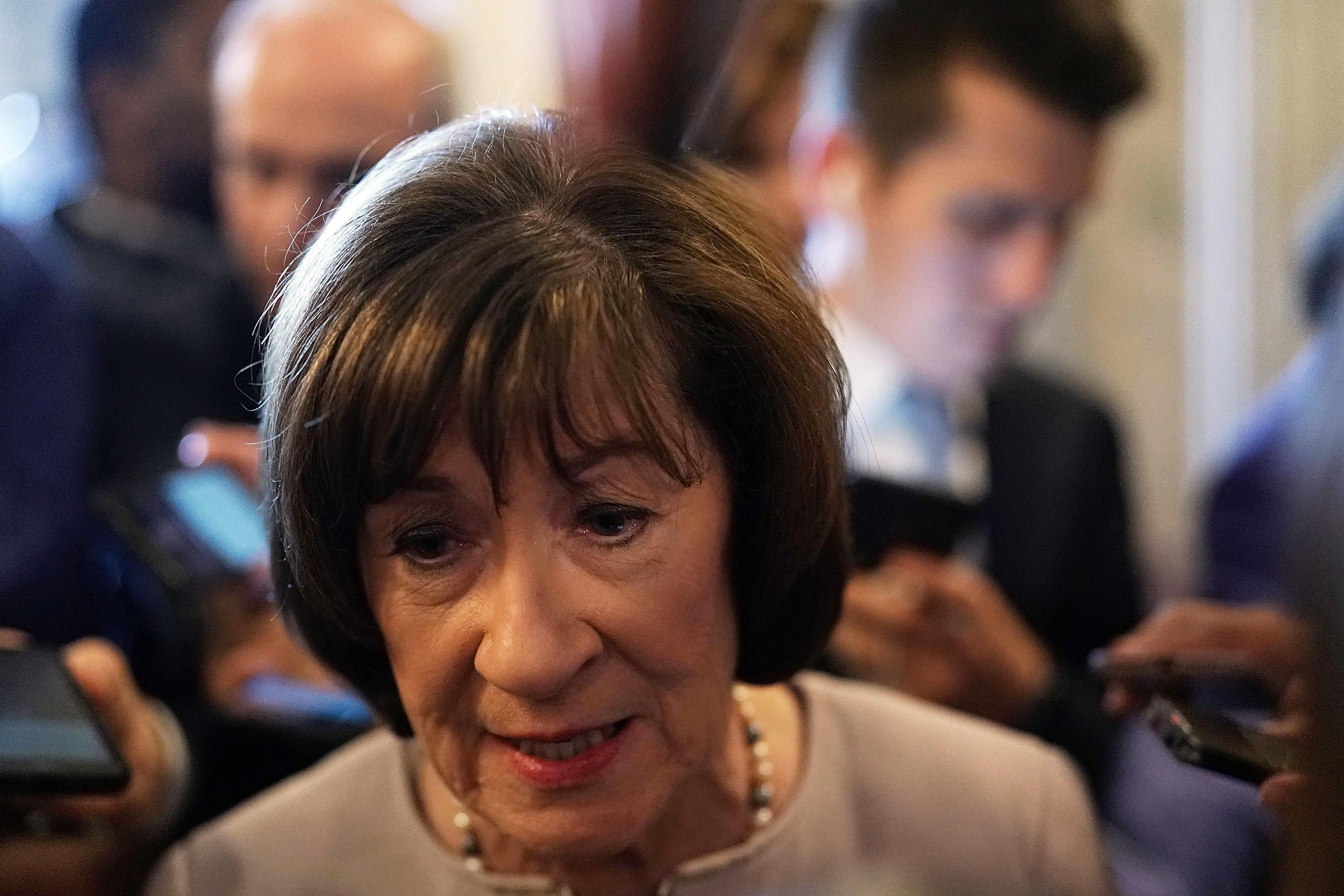 U.S. Sen. Susan Collins speaks to reporters after a floor speech to announce that she will vote for the nomination of Supreme Court Judge Brett Kavanaugh on October 5, 2018 in Washington, DC.