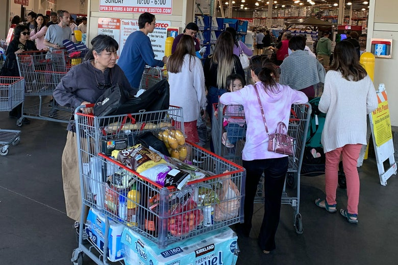Shoppers buy toilet paper, food and water at a store, as people begin to panic buy and stockpile essentials from fear that supplies will be affected by the spread of the COVID-19, coronavirus outbreak across the country, in Los Angeles, California on February 29, 2020.
