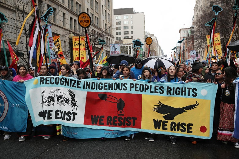 Activists participate in a protest against the Dakota Access Pipeline.