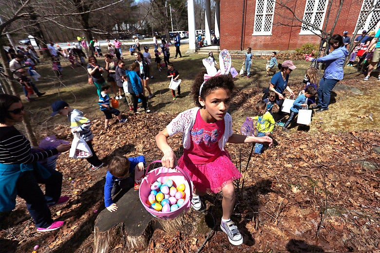Children clear an area of Easter eggs at Falmouth Congregational Church in Falmouth, Maine on April 15, 2017.
