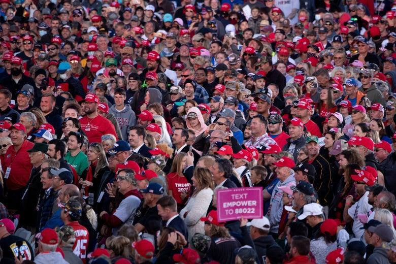 People listen while President Donald Trump speaks during a rally at Bemidji Regional Airport in Bemidji, Minnesota, on September 18, 2020.