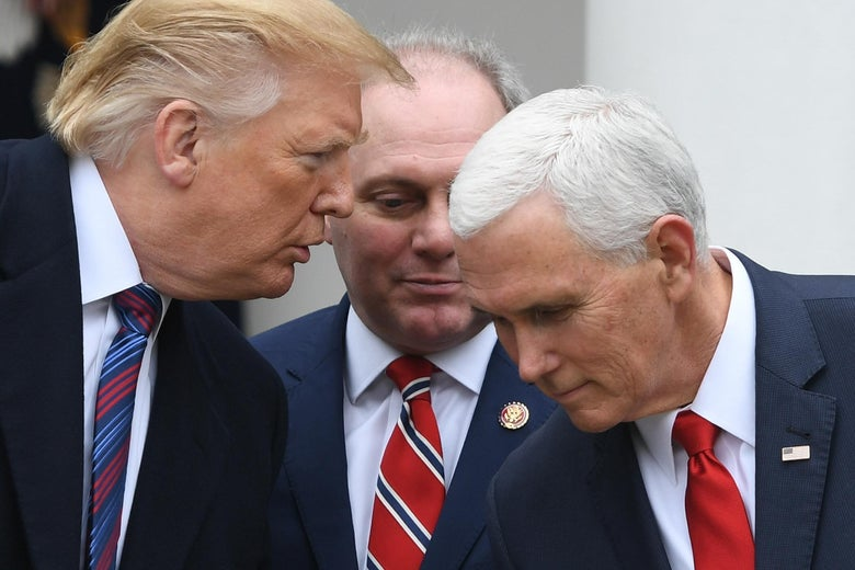 Trump and Pence lean toward one another as Trump speaks to Pence. Steve Scalise sits behind them.
