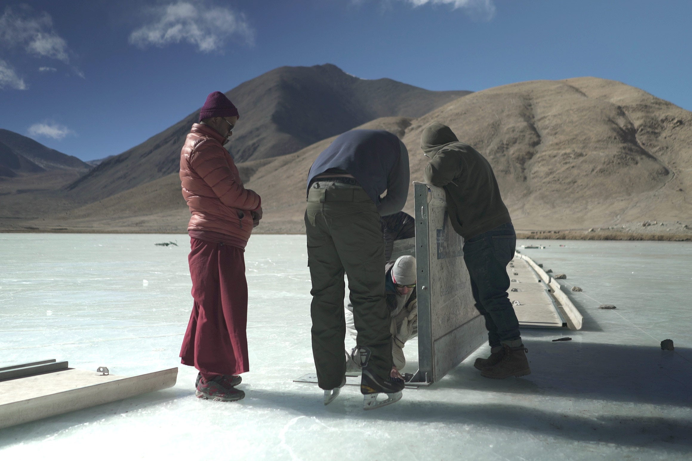Volunteers from the the Hockey Foundation and local Ladakhis set up boards for the hockey rink.
