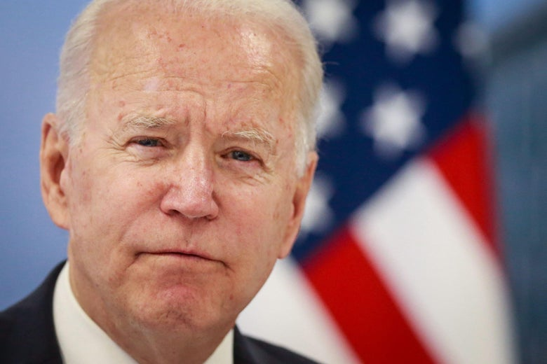 A close-up of Biden's face, looking grave.