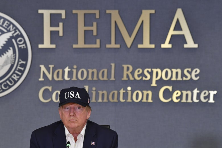 President Donald Trump receives a briefing at FEMA.