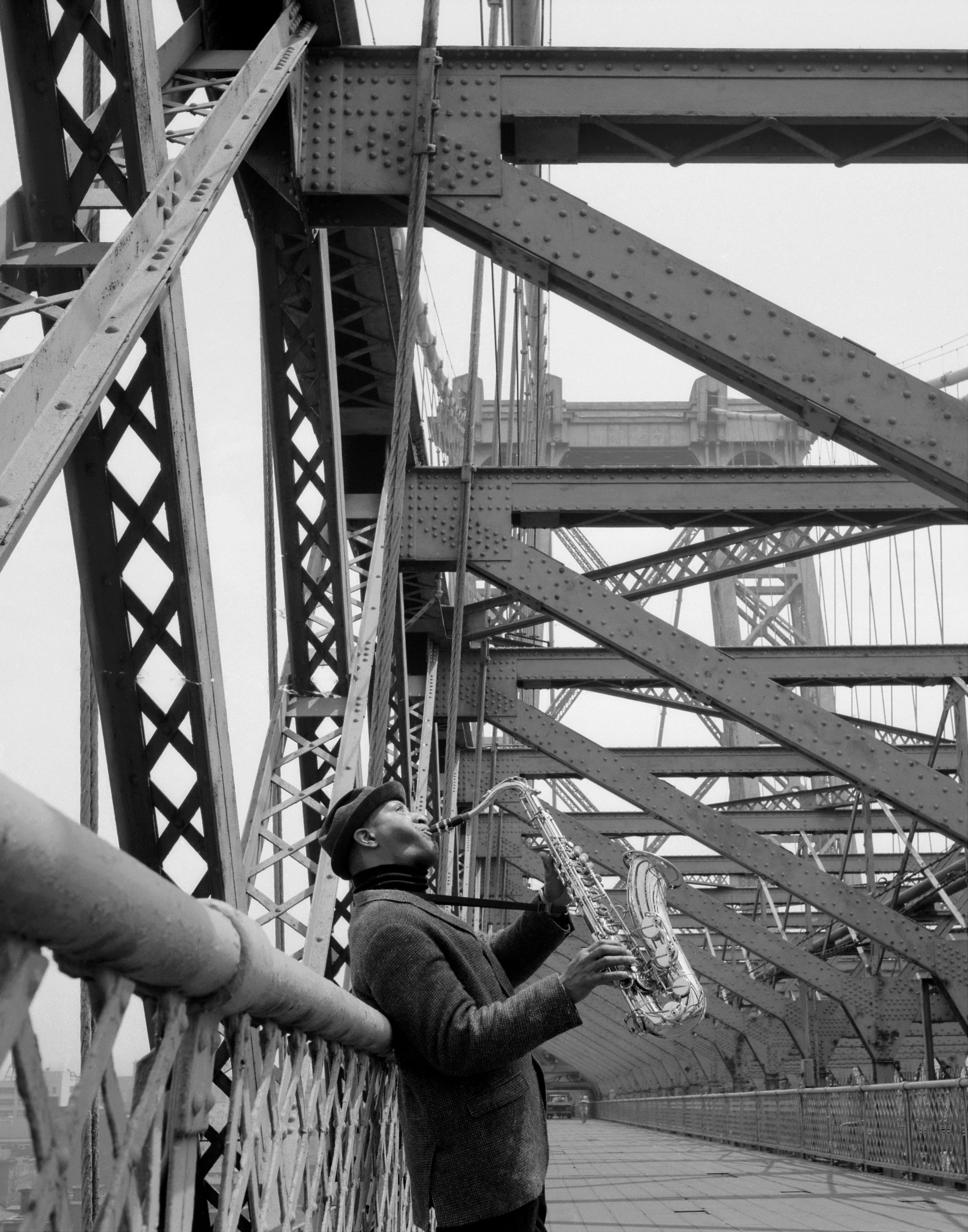 Sonny Rollins plays his saxophone on the Williamsburg Bridge, June 19, 1966.