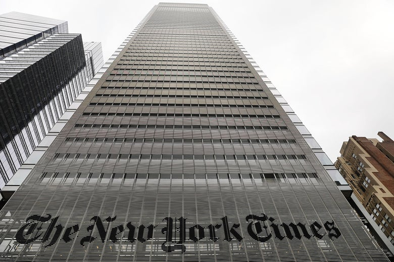 A tall building with the New York Times logo at the bottom is seen.