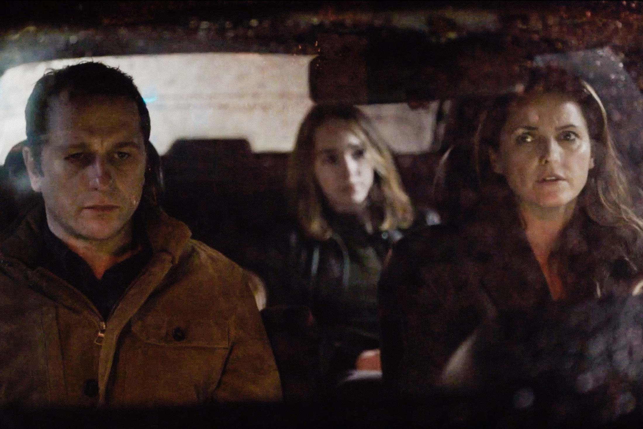 Philip, Elizabeth, and Paige in a car on The Americans.