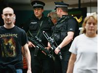 Armed police patrol Glasgow Airport. Click image to expand.