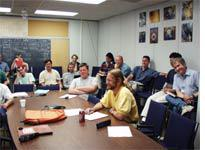 Half of the people who came to the muon meeting (Michael, at table in front)