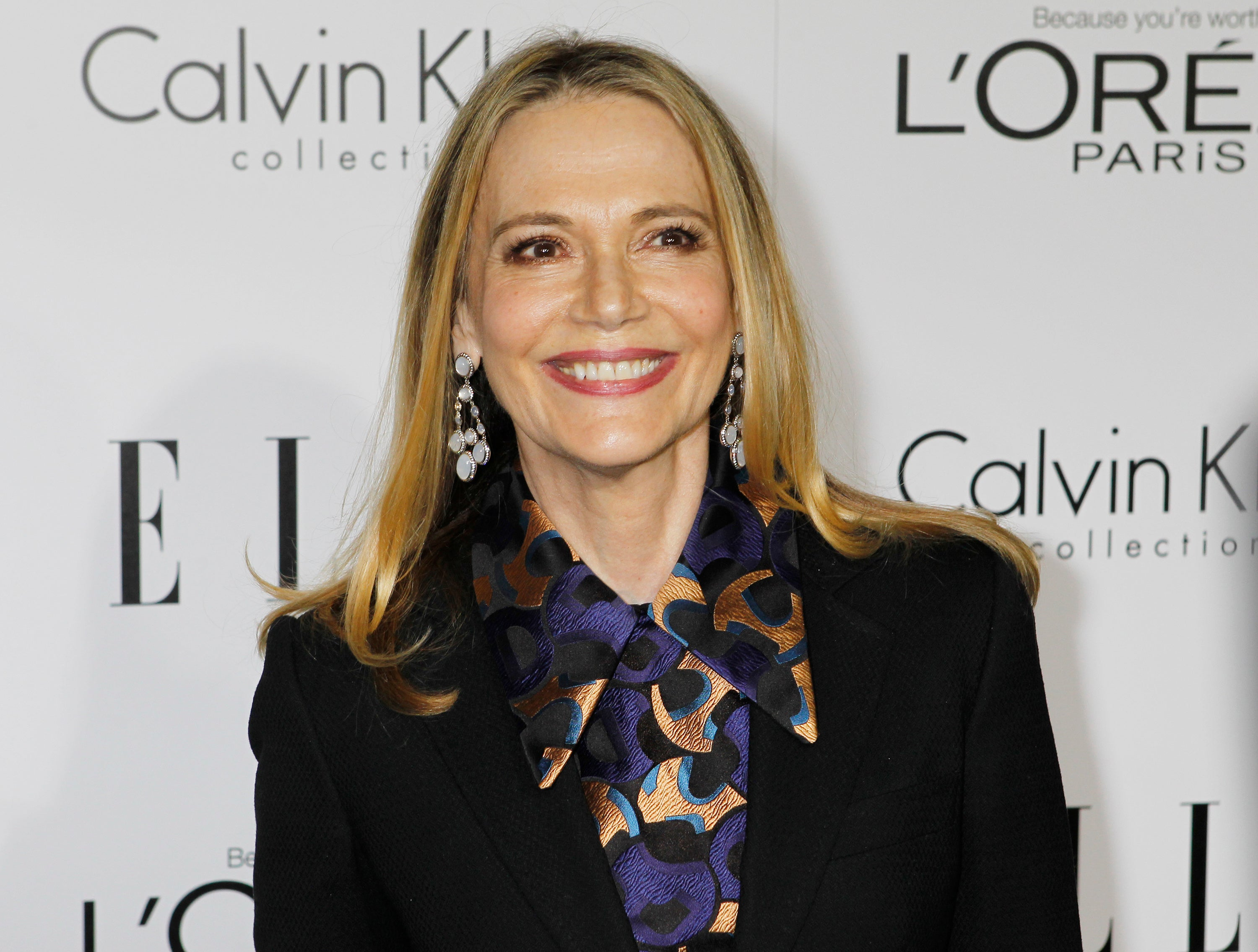 Peggy Lipton smiling on a red carpet.