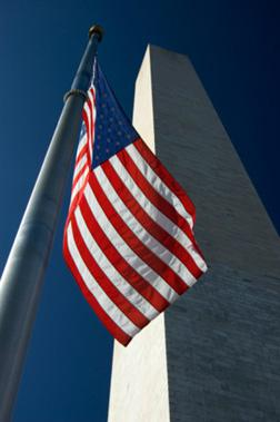 Washington monument with flag. Click image to expand.