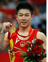 Gymnast Li Xiaopeng of China. Click image to expand.