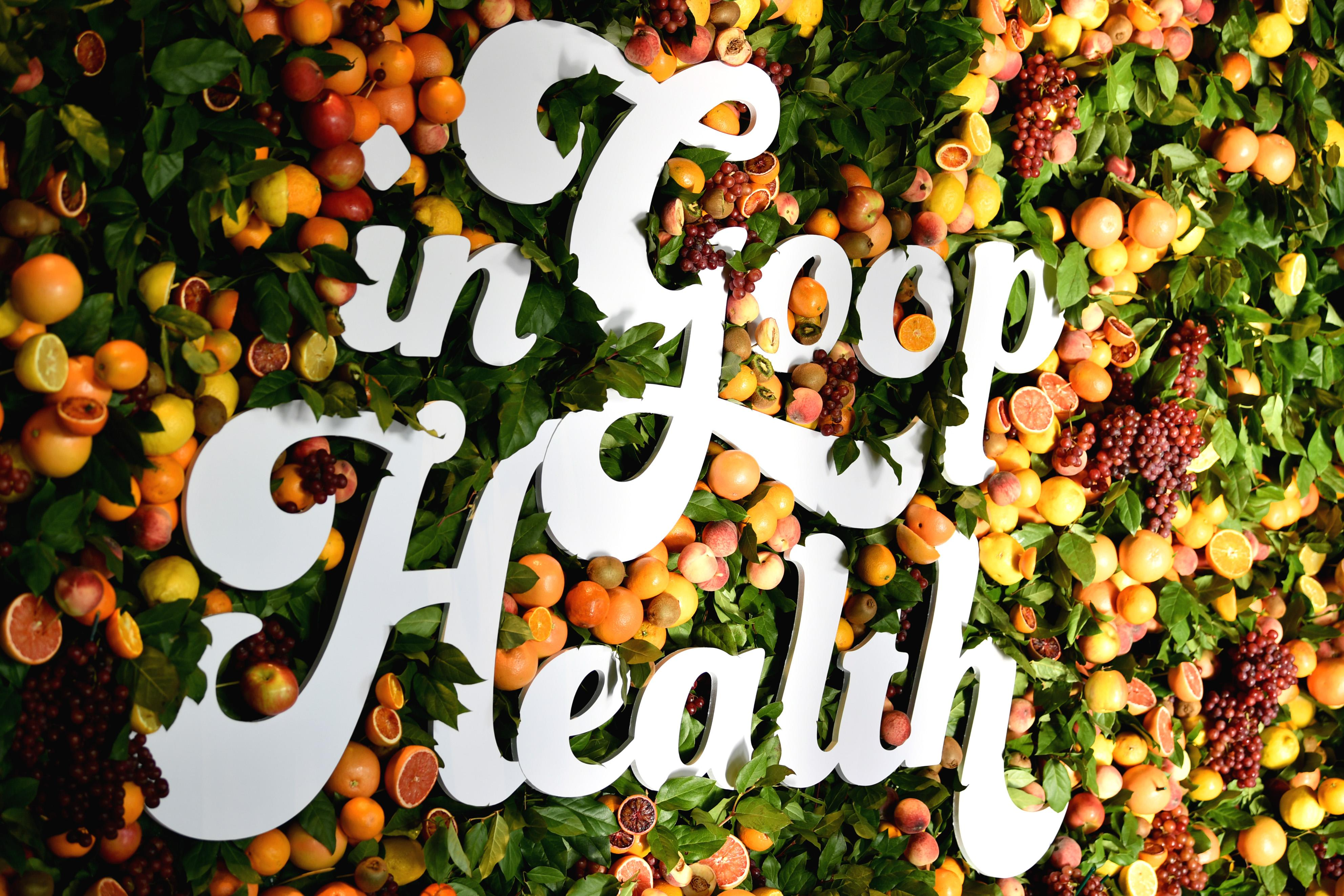 """""""In Goop Health"""" is spelled out in white letters against a floral backdrop."""